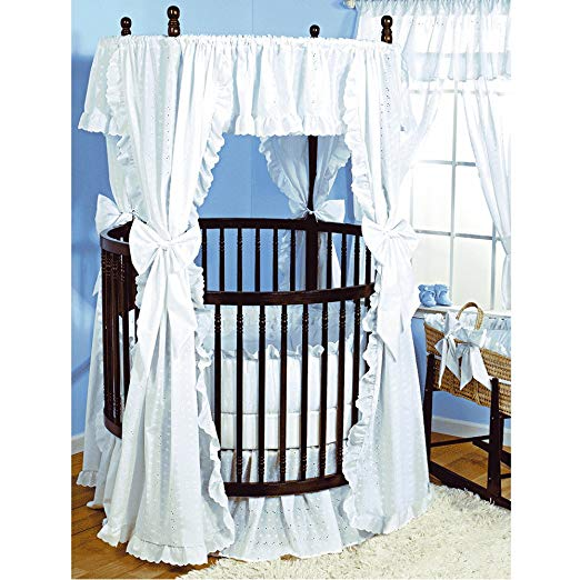 Baby Doll Bedding Carnation comes with a comforter, dust ruffle, fitted sheet, bumper, canopy, drapes and bows