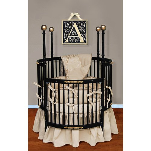 this US-made Baby Doll Bedding Sensation Round Crib set comes with a warm quilted comforter, bumper, fitted sheet and dusting ruffle skirt