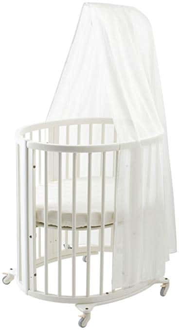This Stokke circular crib features adjustable height position that allows room for a child to grow in